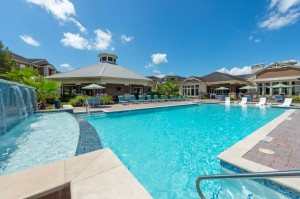Apartments for Rent in Katy, TX - Pool with Waterfall, Tanning Shelf, Lounge Chairs